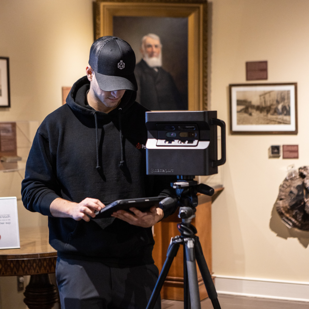 Man stands behind Matterport Pro 2 Camera in the Bytown Museum.