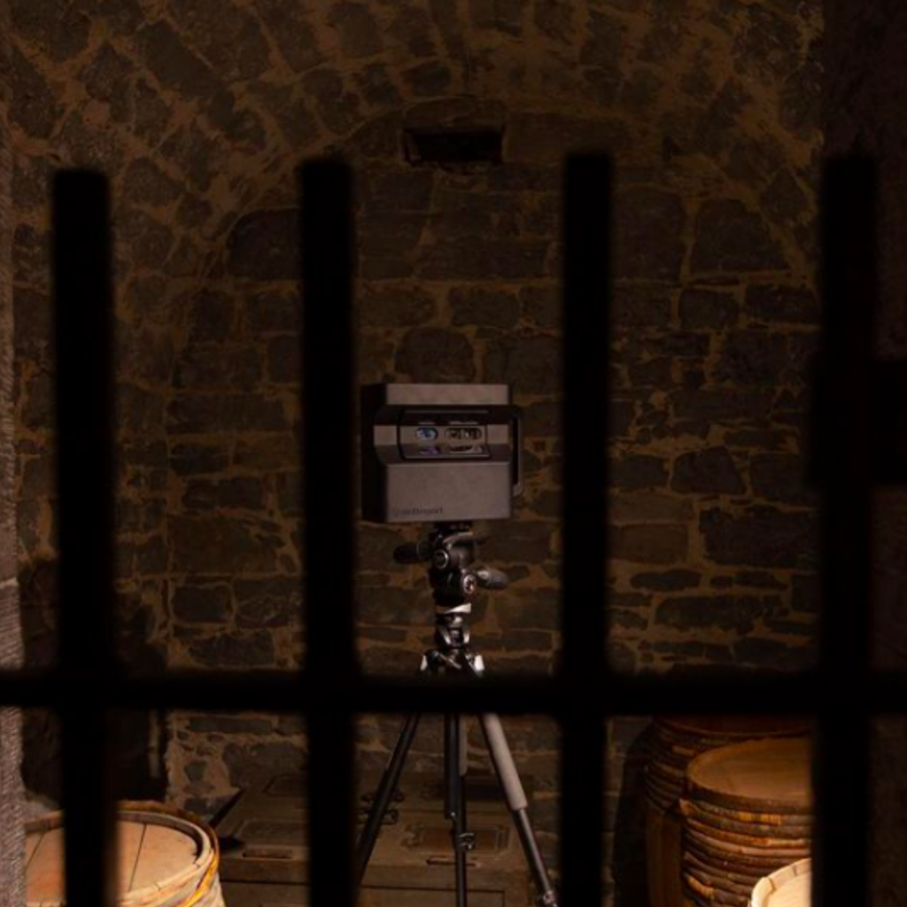 Matterport Pro 2 camera looks out from behind jail cell bars at the Bytown Museum in Ottawa, Ontario.