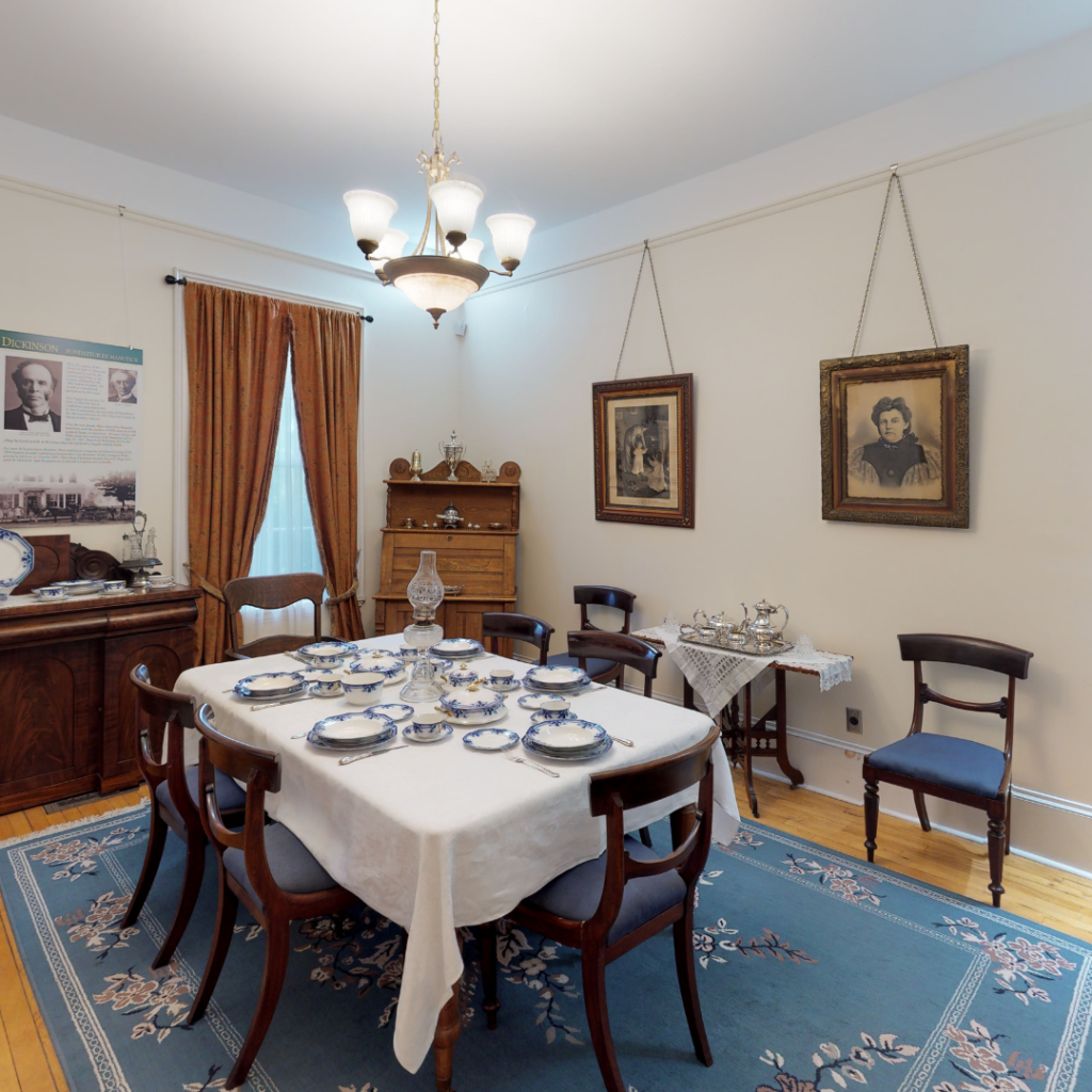Dining room at the Dickinson House in Ottawa Ontario. Dining table with white tablecloth is set in Heritage House. ,