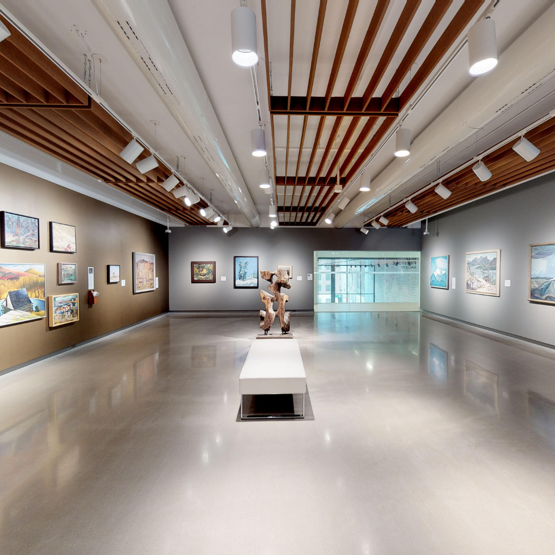 Screen capture from the 3D Virtual Tour of the OAG Firestone Exhibit. The photo features a museum exhibit space with a small statue in the middle.
